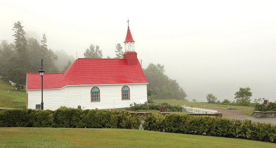 """Scenery from Village of Tadoussac in foggy summer morning, Quebec-Canada."""